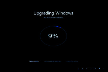 PARIS, FRANCE - JAN 7, 2016: Upgrading windows message on computer screen during the upgrade from Windows 8.1 to Windows 10