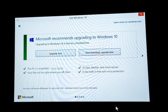 PARIS, FRANCE - JAN 7, 2016: Two option on computer screen - Start Download and Start Download and Upgrade later during the upgrade to Microsoft Windows 10
