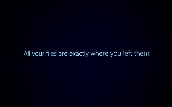 PARIS, FRANCE - JAN 7, 2016: All your files are exactly where you left them message on computer display during Windows 10 upgrade