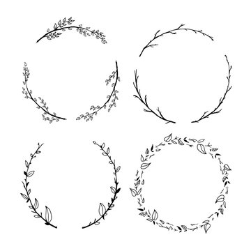 Set of cute detailed hand drawn floral wreaths isolated on white