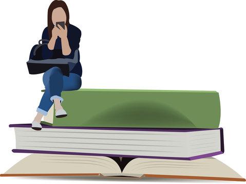 ragazza seduta sui libri chatta con il cellulare
