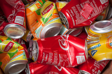 closeup of coca cola and lipton ice tea can for recycling