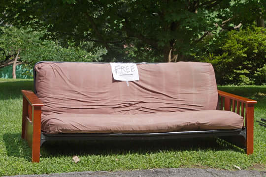 Futon With a Free Sign By the Side of the Road