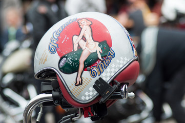 Closeup of pin up painting on motorbike helmet at fun car show event