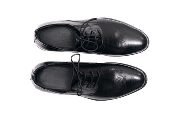 Black leather shoes isolated on a white background. Wall mural