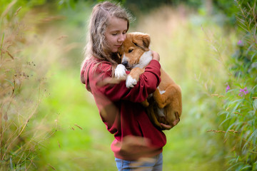 Teenage girl with cute bordertoller mix breed puppy