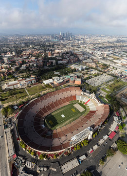 Aerial view of the historic Los Angeles Memorial Coliseum stadium with downtown in background on April 12, 2017 in Los Angeles, California, USA.