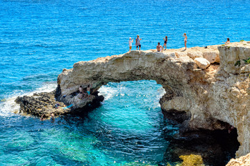 AGIA NAPA, CYPRUS - July 21 2019: view of Lovers bridge arch with tourists.