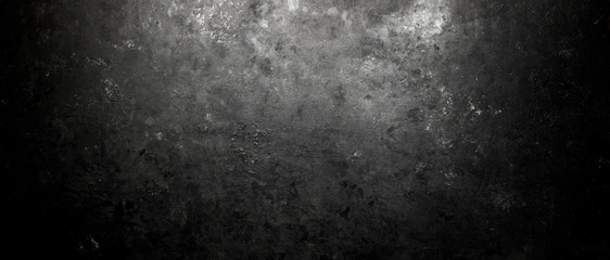 Rough, dark stone background lit by spotlight background Wall mural