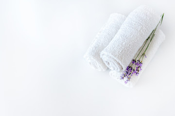 white clean towels and lavender flowers on white isolated background