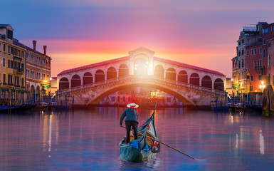 Gondolier carries tourists on gondola near Rialto Bridge - Venice, Italy Wall mural