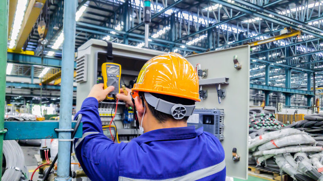 Electrical engineer are working on factory site, Technician check fault in power control unit on factory site