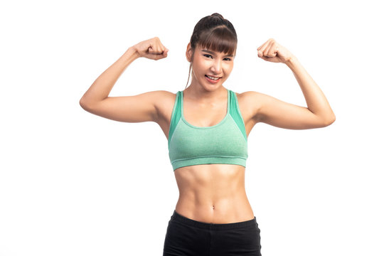 Fitness woman white background. Asian woman. Showing arm muscle, happy smile.
