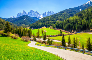Alpine road with a beautiful view in Santa Maddalena village, Dolomites, Italy.