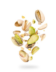 Pistachios crushed into many pieces on a white background