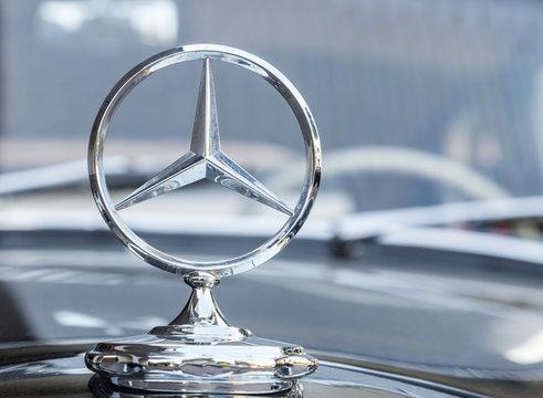 Stuttgart,Germany- August 11,2013: Mercedes logo on a traditional car