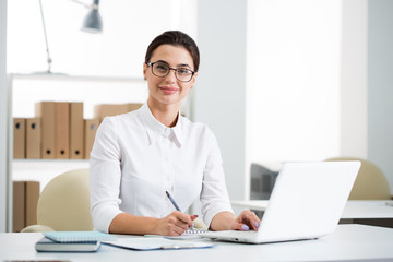 Young beautiful businesswoman with computer