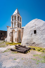 Kythira Island, Greece. Medieval churches of Panagia Myrtidiotissa and Panagia Orfani with old cannons in the Chora castle.