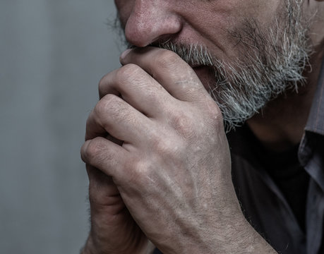Close up pensive senior man on dark background