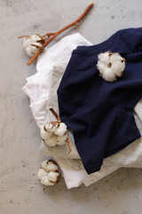 natural organic clothing from with twigs of cotton