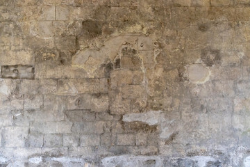 Poster de jardin Vieux mur texturé sale Ancient repaired limestone building wall