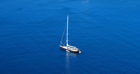 aerial view of boat in the sea and blue water