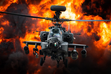 In de dag Helicopter A AH-64 Apache attack helicopter in front of a large explosion.