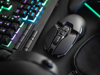 e-sport concept with gaming gear, mouse, keyboard, joystick, headset, mobile joystick, in ear...