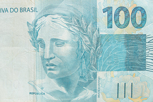 Brazilian hundred real banknote. Blue note, 100 reais brl. Brazilian money, real note. Macro photo.