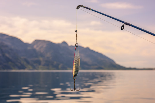 Fishing Hook and Rod In Beautiful Norwegian Landscape