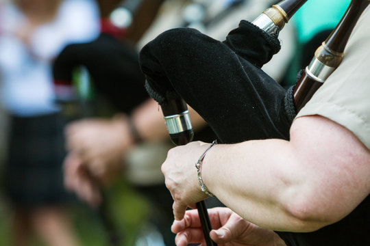 Closeup Female Hands Playing Bagpipes At Festival