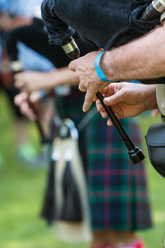 Closeup Male Hands Playing Bagpipes At North Georgia Event