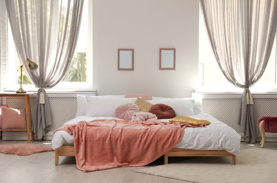 Stylish modern room interior with comfortable double bed