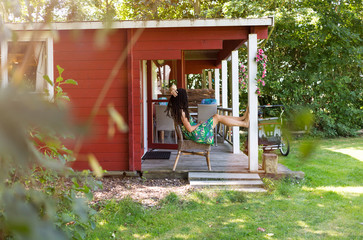 Fototapeta Young woman on porch of summer house obraz