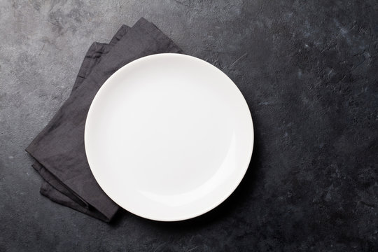 Kitchen table with empty plate and towel