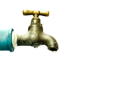 Dripping old brass water tap isolated on white background, with clipping path , water drops, exterior, day. Water