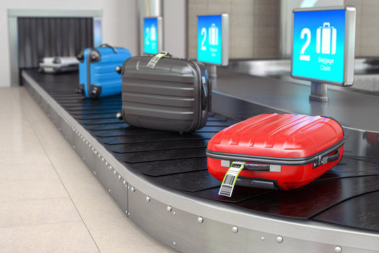 Baggage claim in airport terminal. Suitcases on the airport luggage conveyor belt.