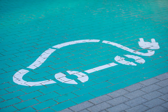 Road sign of electric car battery recharge station.