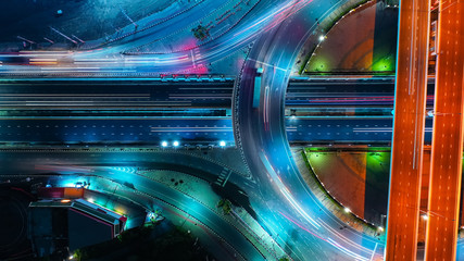 Tuinposter Nacht snelweg Aerial view Expressway motorway highway circus intersection at Night time Top view , Road traffic in city at thailand.