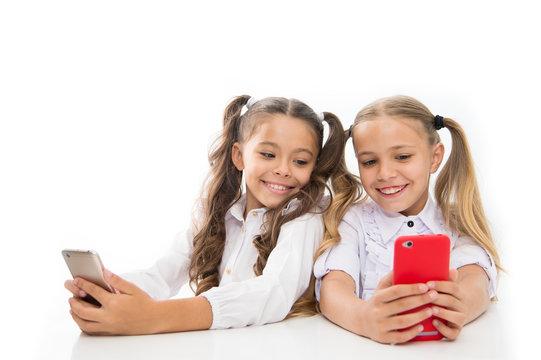Online communication. Create online web blog. Follow social networks. Gaming online. Blogger school. Educational application. Schoolgirls smartphones surfing internet social networks. Send message