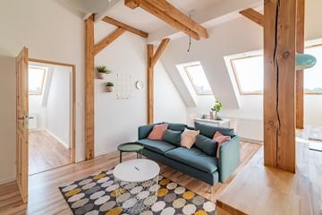 Bright attic living room in the loft apartment