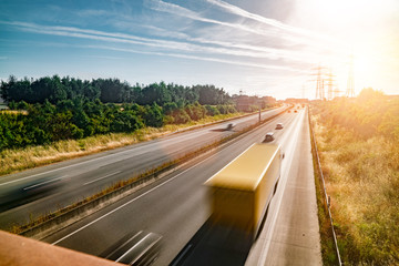 Wall Mural - Lots of Trucks and cars on a Highway - transportation concept