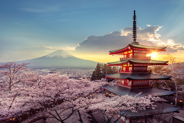 Fototapeten Blau Jeans Fujiyoshida, Japan Beautiful view of mountain Fuji and Chureito pagoda at sunset, japan in the spring with cherry blossoms