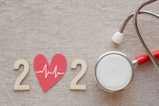 2020 wooden number with red stethoscope. Happy New Year for heart health resolution goal and medical concept, life insurance business, health resolution