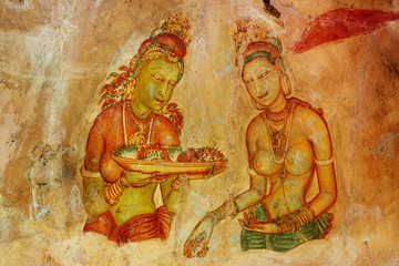 Sigiriya maiden with fruits: one of the 5th century frescoes at the ancient rock fortress of Sigiriya, a UNESCO World Heritage Site in Sri Lanka