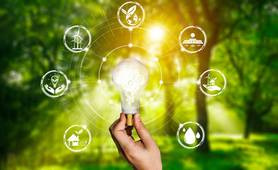 Green energy innovation light bulb with future industry of power generation icon graphic interface....