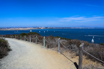 A rope fence along the Bayside Trail at Cabrillo National Monument in Point Loma, California which offers breathtaking views of San Diego Bay.