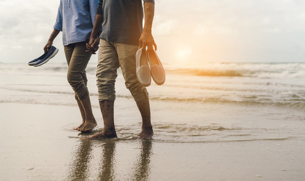 Couple senior elder retire resting relax walking at sunset beach honeymoon family together happiness people lifestyle