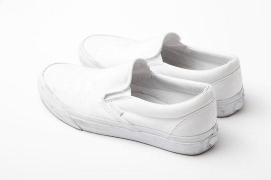 Canvas white sneaker on white background.