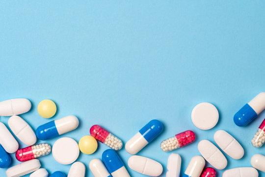 Studio shot of medical pills on blue background